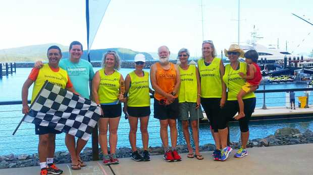 Airlie Beach parkrun volunteers with returning athlete Bob Barford at the finish line on Saturday morning.