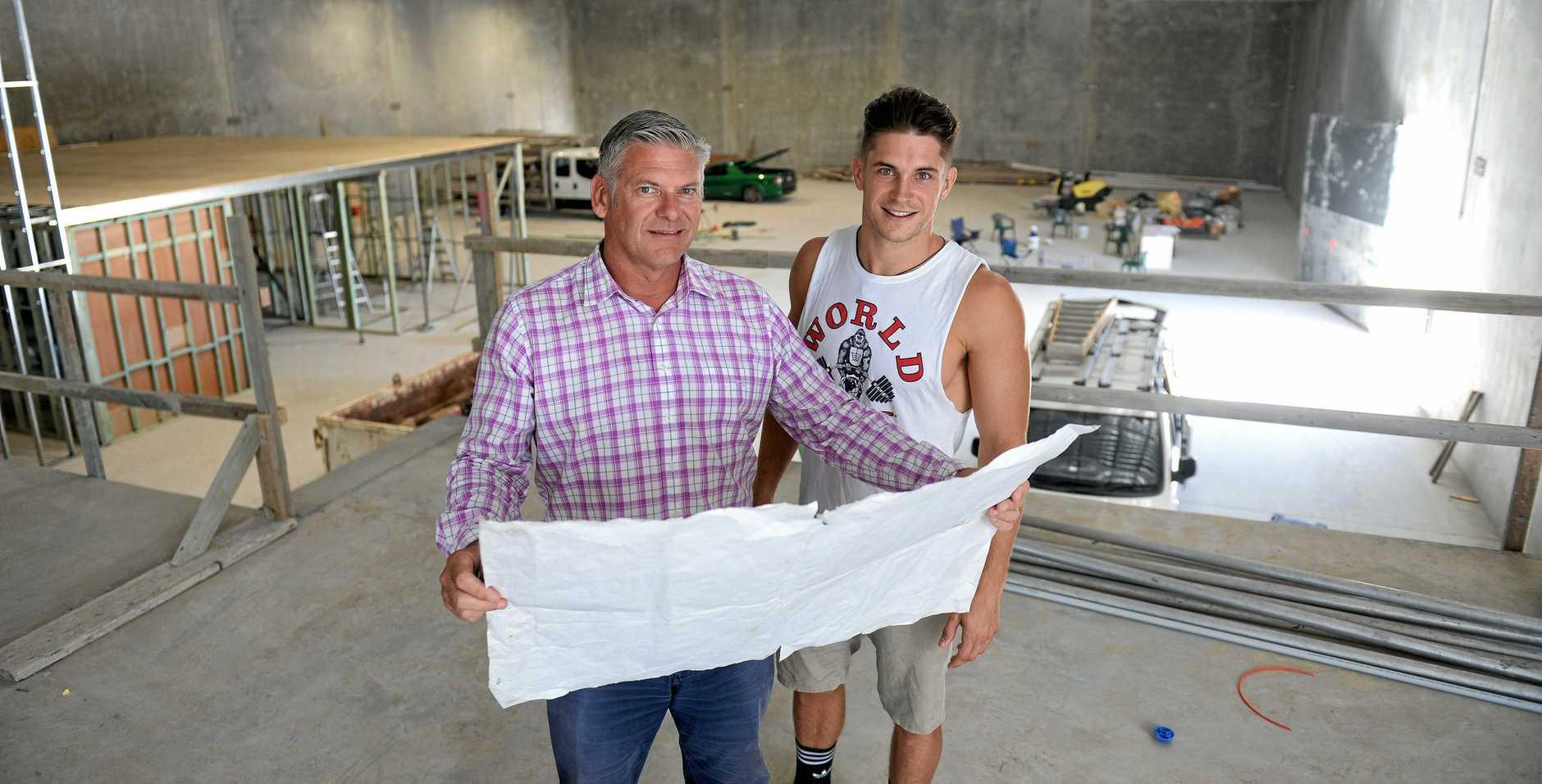 World Gym owners Dominic and Darcy Edwards inside the massive Bundamba location.