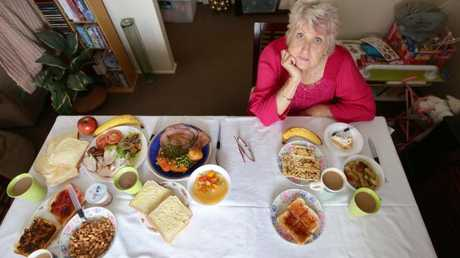 Pensioner Faye Trewick, 70, from Woodridge, compares her daily food allowance (right) to that of a prisoner's (left).