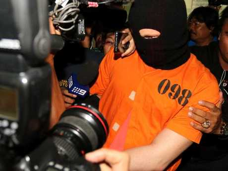 Roberts was paraded before media after his arrest. Picture: Lukman Bintoro