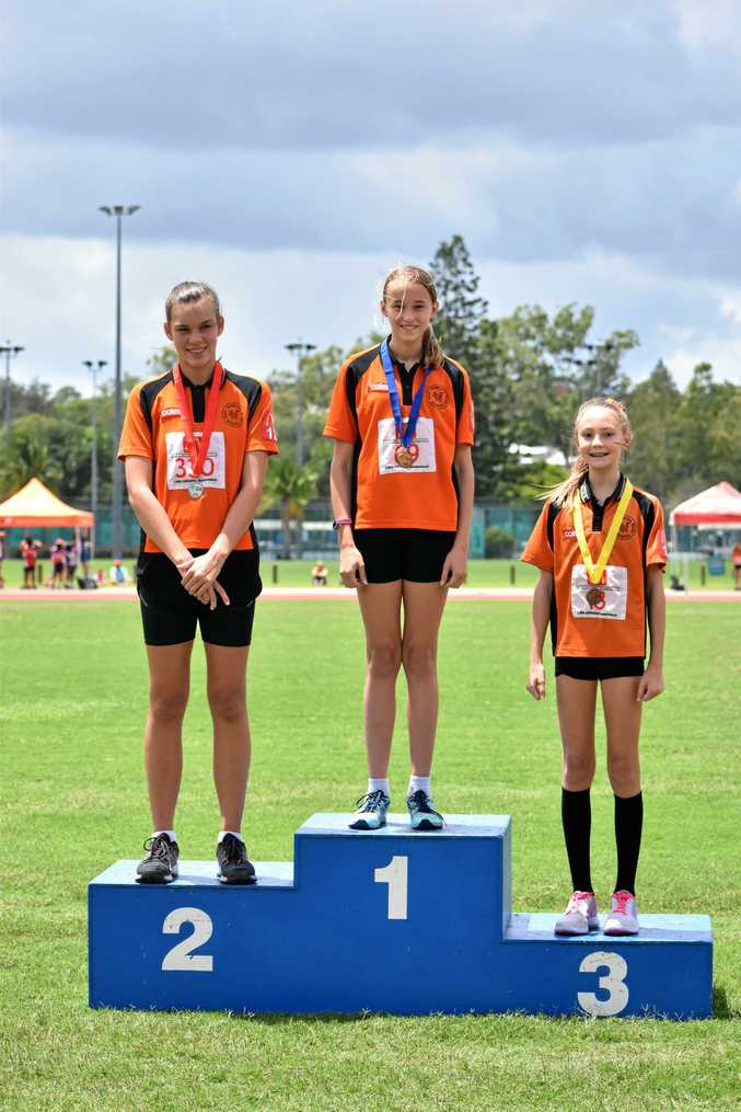 Ipswich under 12 girls who dominated the high jump: Claire Bellingham (first), Molly Green (second) and Toby Stolberg (third).