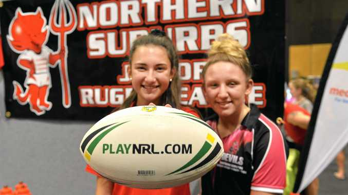 LEAGUE LOVERS:Norths under-17s Lara Whippy and Ataliah Love show their true colours.