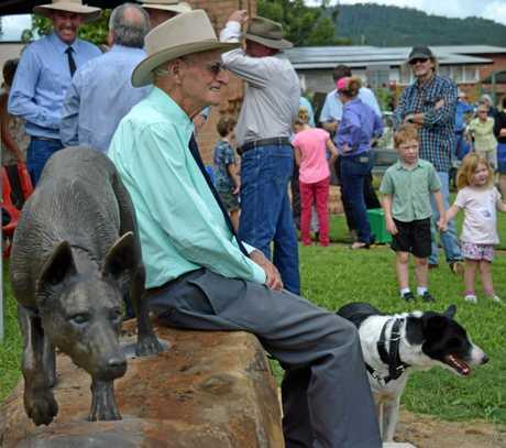 Fraser Ramsey sits next to the new Bonalbo dog statue.
