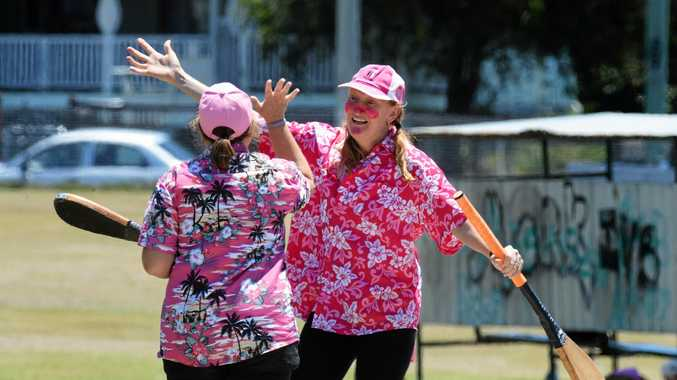 Well-dressed players in pink share in the spirit of the Ipswich Vigoro Association's annual Pink Stumps Day.