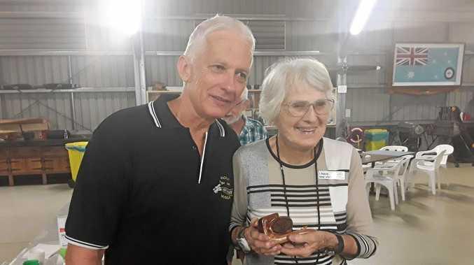Museum president Ross Robotham awarding Irie Dalrymple a life membership.