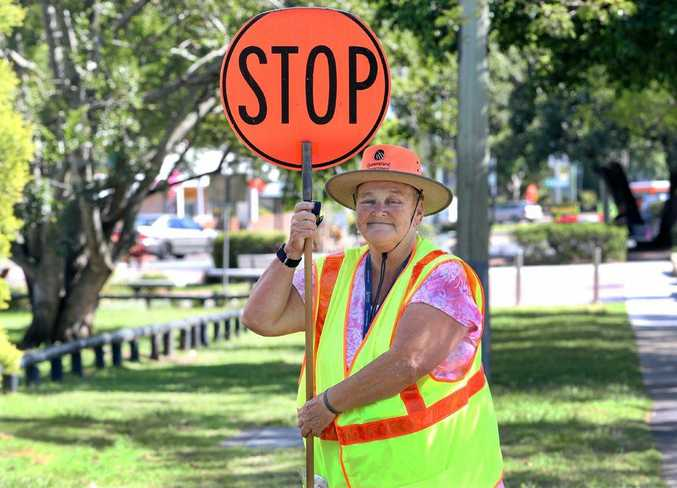 ROAD TO SUCCESS: June Young has helped generations of students cross the road safely.