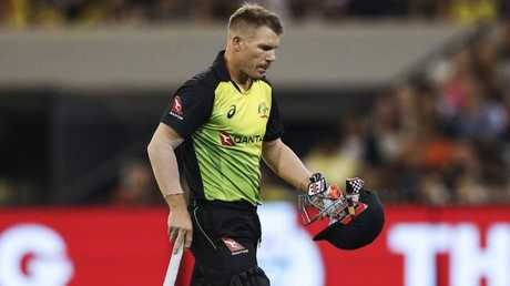 Australia's David Warner trudges off the field.