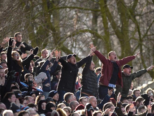 Aston Villa fans celebrate against Birmingham.