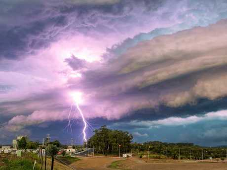 A lightning strike and storm clouds at Redbank Plains.  Picture: Murray Fox