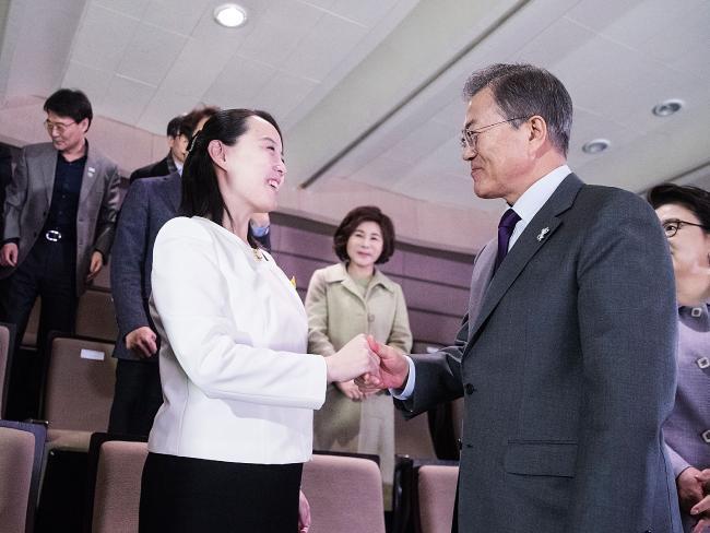 Kim Jong-un's sister Kim Yo-jong and South Korean President Moon Jae-in shake hands in Seoul. Picture: South Korean Presidential Blue House/Getty Images