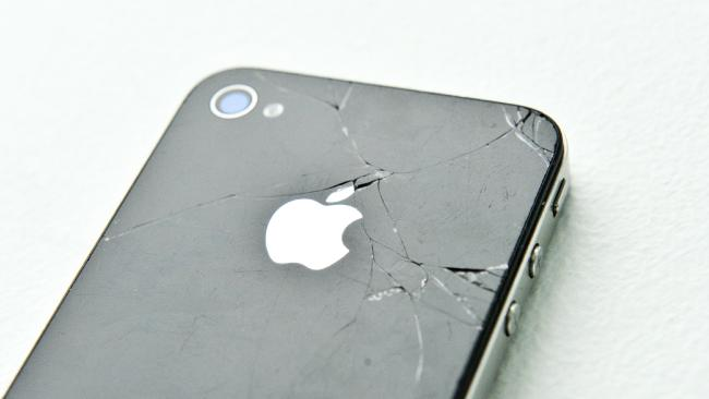 An Apple iPhone with a broken screen is a familiar sight.