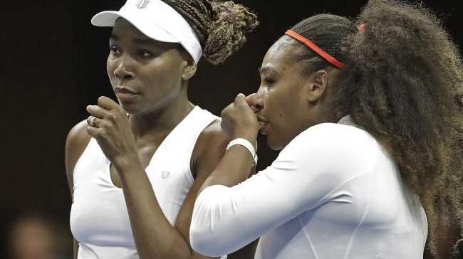 USA's Venus Williams, left, and Serena Williams
