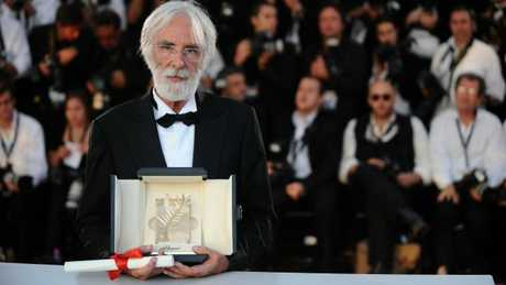 Michael Haneke poses after being awarded with the Palme d'Or for his movie The White Ribbon at the Cannes Film Festival in 2009. Picture: AFP