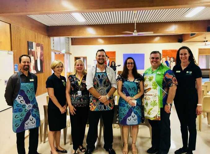 DDHHS Executive members Dr Paul Clayton, Andrea Nagle, Jane Ranger, Paul Barber, Shirley-Anne Gardiner, Dr Martin Byrne and Corinne Butler. The DDHHS Executive donned their aprons to prepare a barbeque breakfast for those attending this morning's commemoration of the 10th anniversary of the apology to the Stolen Generation.
