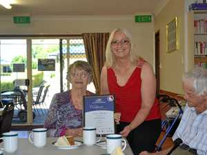 Local hero presented with community achivement award