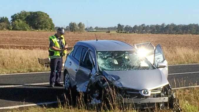 CRASH: Emergency services on the scene of the head-on crash at the Bundaberg-Gin Gin Rd involving Melody Chi-Kwun Cheung.