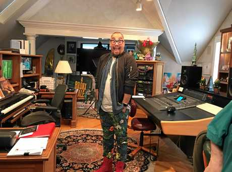 Australian actor Gareth Jacobs in the home studio of composer Alan Menken.
