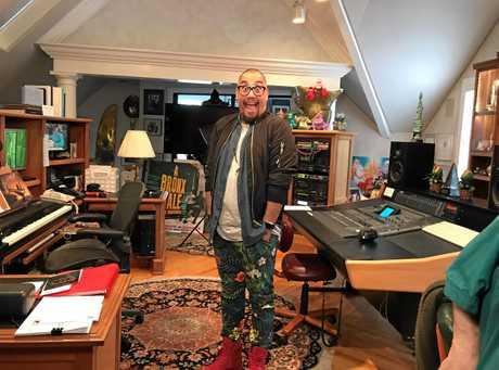 Australian actor Gareth Jacobs in the home studio of composer Alan Menken.