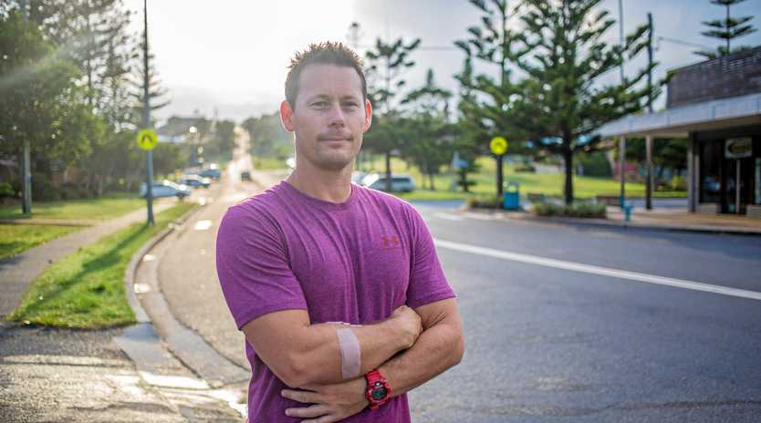 Michael Burg helped when he saw a friend's pet being attacked by another dog in Woolgoolga.