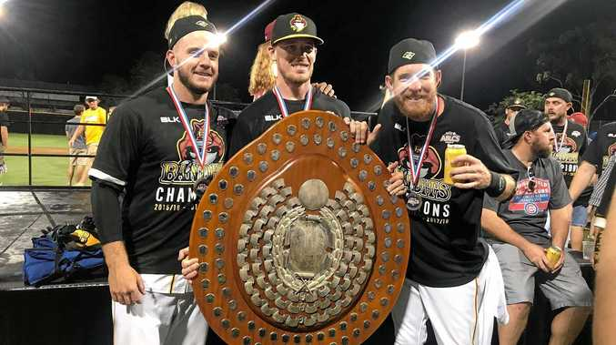 CHAMPIONS AGAIN: Ipswich Musketeers Andrew Campbell, Rhys Niit, and Wade Dutton with the ABLCS Claxton Shield. The Brisbane Bandits won for a third straight season on Sunday night.