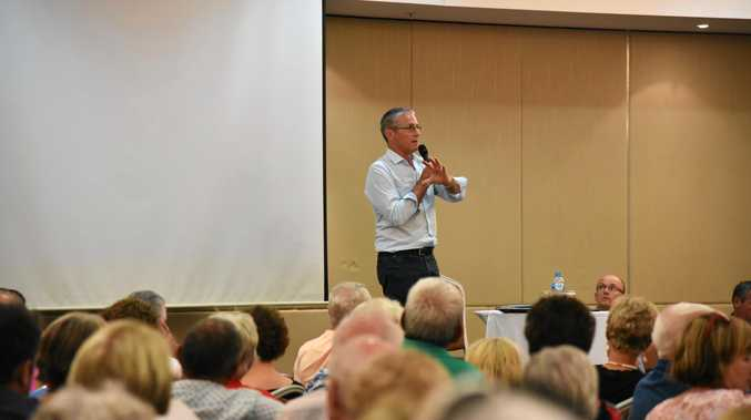 DEVELOPMENT DRAMA: Councillor Tim Dwyer at the public forum to discuss development of the Pelican Waters Golf Club.