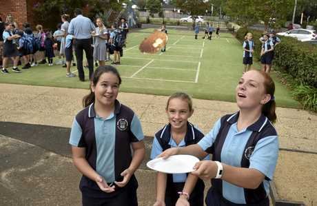 PANCAKE TUESDAY: Enjoying their pancakes before school are (from left) Charlize Bishop, Charlotte Baker and Eliza Morcom at Our Lady of Lourdes Primary School to mark Shrove Tuesday.