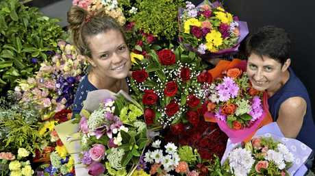 LOVE IN THE AIR: Preparing bouquets of flowers for Valentine's Day today are Jess Olsen (left) and Tammie Olsen at the Toowoomba Flower Market.