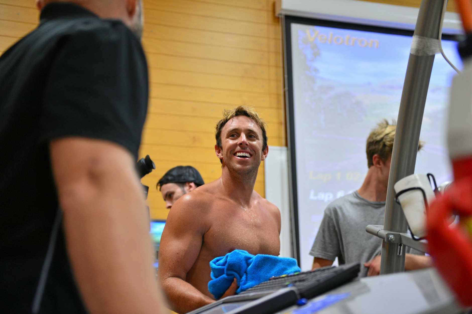 Mark Visser is put through a gruelling fitness test at Sunshine Coast University under the watchful eye of  Lab technician Stephen Bishop.  Photo: John McCutcheon / Sunshine Coast Daily