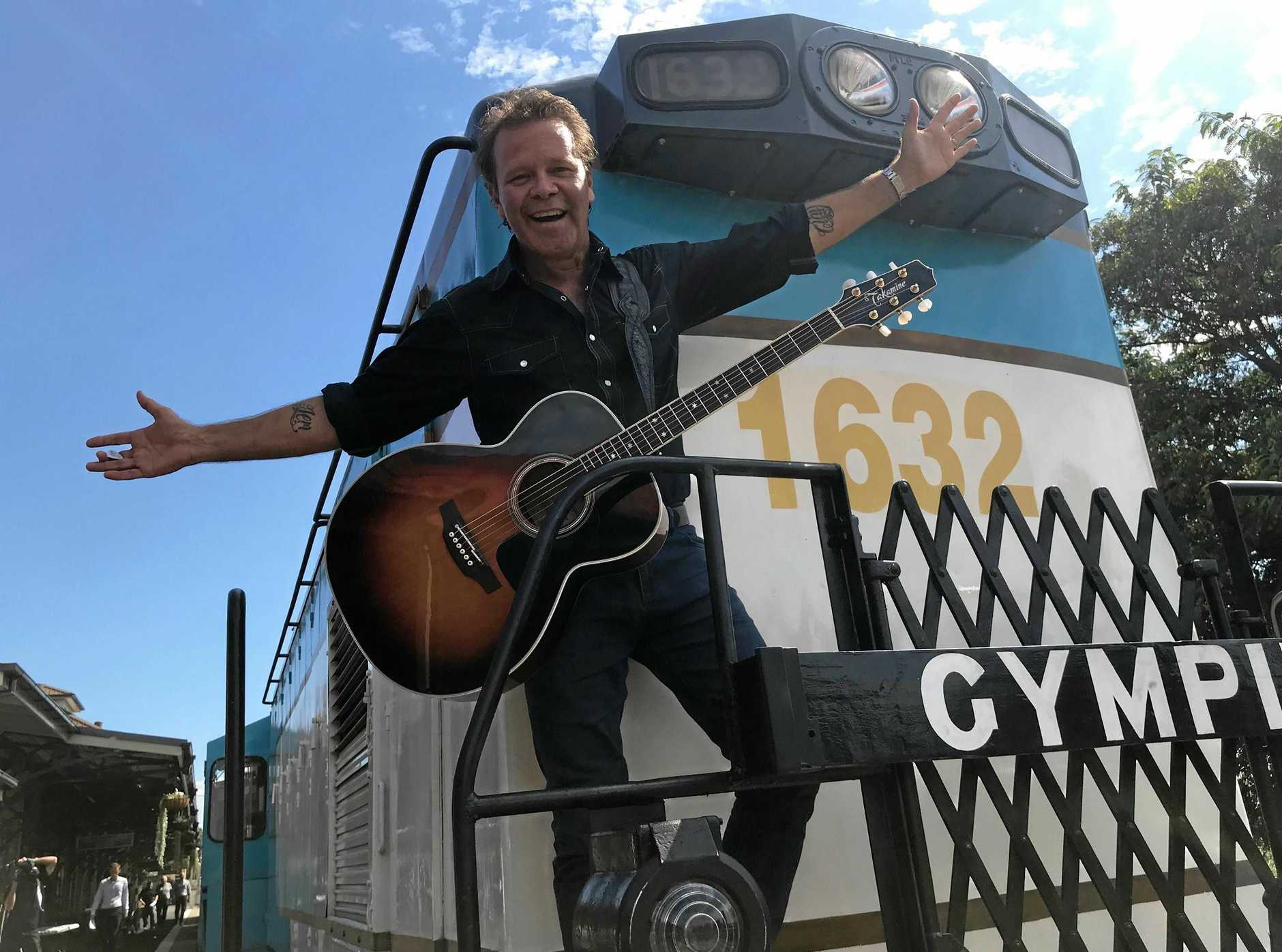 ALL ABOARD: Troy Cassar-Daley gets set to climb aboard the Muster train.