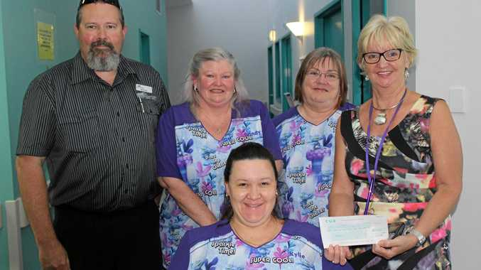 GIFT OF COMFORT: The Caring Carriers Michael Beck, Sandra Tench, Julie Wheeler and Kylie Hill and Hervey Bay Hospital unit nurse manager Pam Harsant.