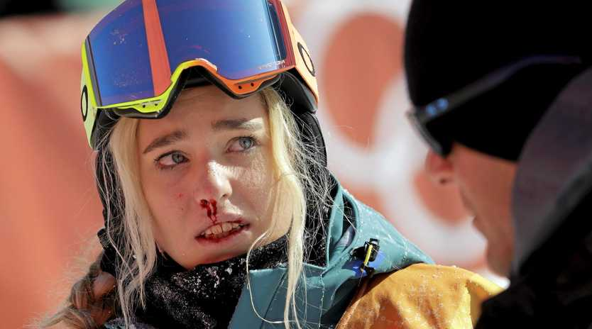 Emily Arthur is helped off the course after crashing during the women's halfpipe final.