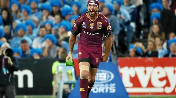 Jonathan Thurston of the Maroons wears his trademark head guard.