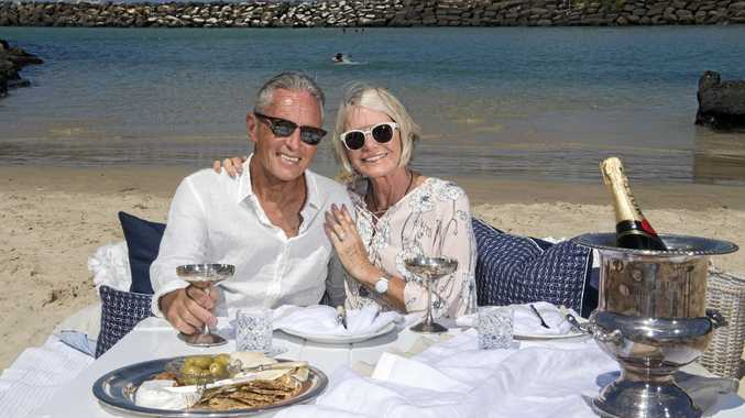 TRUE LOVE: Terry Seeman and Heather Usher enjoy a romantic picnic on the beach at Cudgen Creek ahead of Valentines Day.