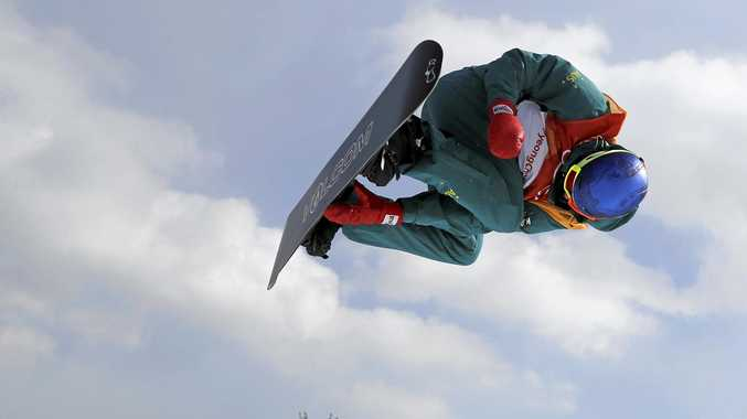Scotty James flies high during the men's snowboard halfpipe qualification run.