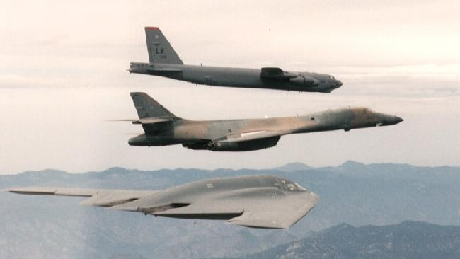Three generations of US strategic bombers in flight. The B-52