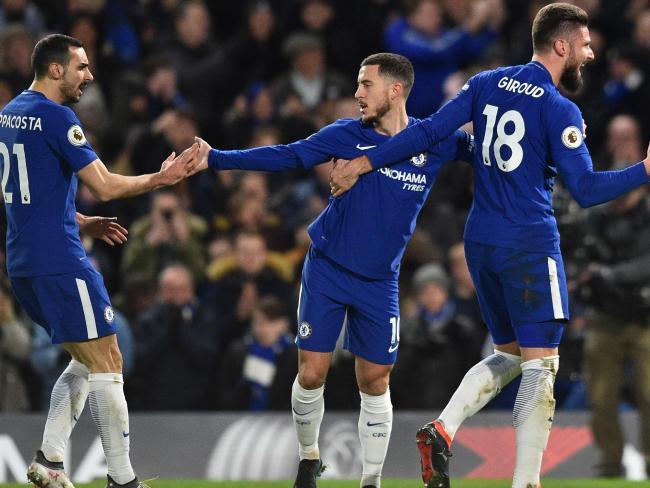 Chelsea's Belgian midfielder Eden Hazard (C) celebrates.