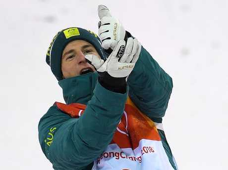 Matt Graham gestures on the podium after winning the silver medal in the Men's Moguls Final at Phoenix Snow Park during the PyeongChang 2018 Winter Olympic Games.