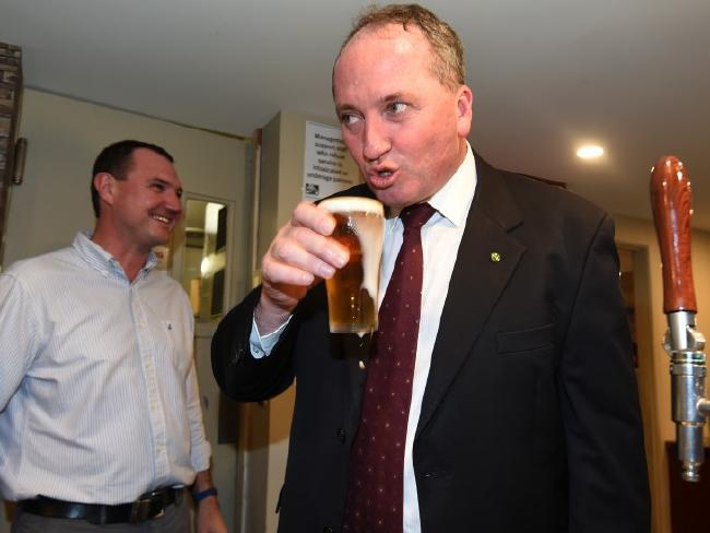Deputy Prime Minister Barnaby Joyce drinks a beer at the Burpengary Tavern in the federal seat of Petrie, in Brisbane, in May 2016. Picture: AAP Image/Dan Peled