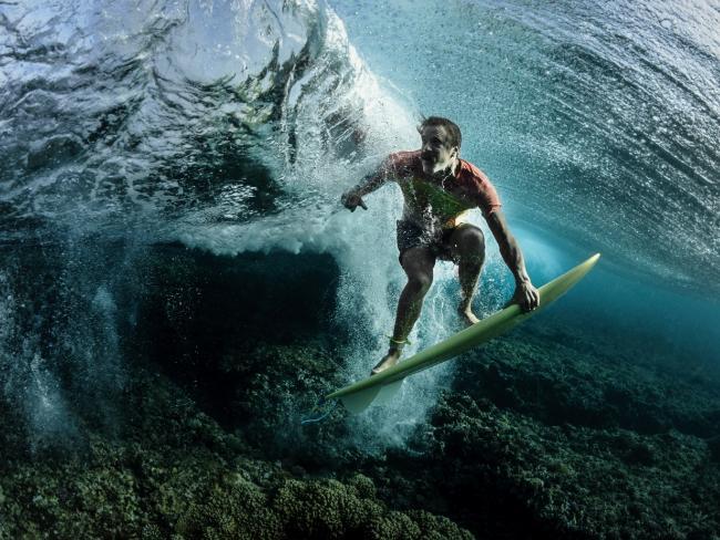 Rodney Bursiel's Under The Wave Country depicts musician and professional surfer, Donavon Frankenreiter at Cloudbreak. Picture: Rodney Bursiel/UPY 2018