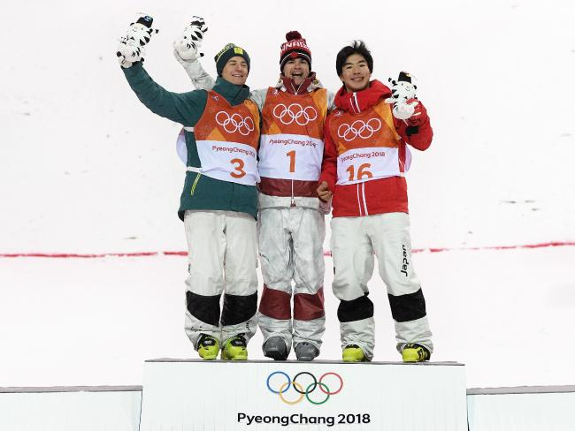 (L-R) Silver medalist Matt Graham of Australia, gold medalist Mikael Kingsbury of Canada and bronze medalist Daichi Hara of Japan pose during the victory ceremony.