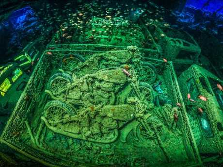 Tobias Friedrich's was named Underwater Photographer of the Year 2018 for his panorama of British World War II military vehicles with soldierfish schooling above. Picture: Tobias Friedrich/UPY 2018