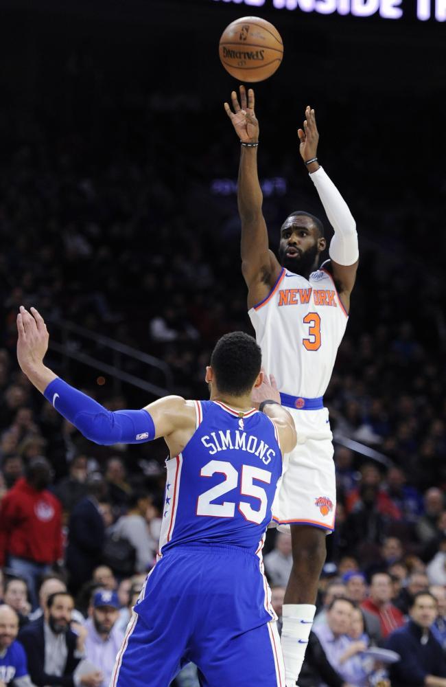 The Knicks' Tim Hardaway Jr. takes a shot over Simmons. (AP Photo/Michael Perez)