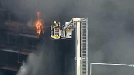 Fire engulfs building near Sydney's Circular Quay train station