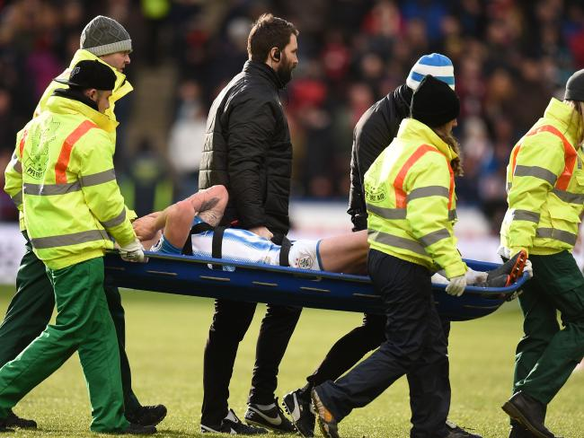 Huddersfield Town's Australian midfielder Aaron Mooy is stretchered off.