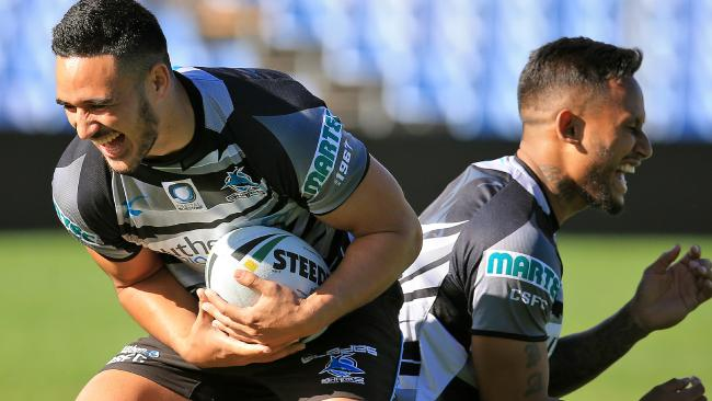 Holmes and Barba competing at training for the Sharks in 2016.