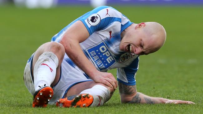 Aaron Mooy of Huddersfield Town goes down injured.