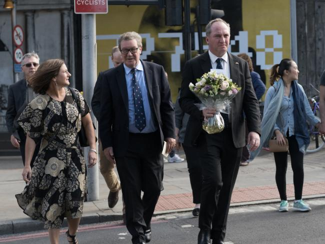 Deputy Prime Minister Barnaby Joyce and his wife Natalie (left) paying their respects at London Bridge in late June. Picture: Christopher Chan