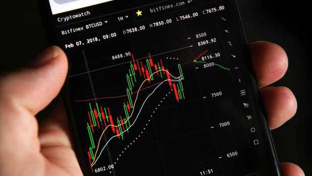 An investor watches cryptocurrency prices. Picture: Dave Hunt/AAP