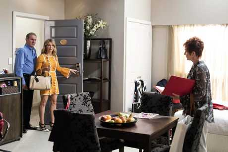 Alan Fletcher, Natalie Bassingthwaighte and Jackie Woodburne in a scene from Neighbours.