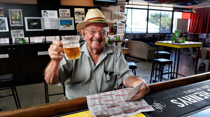 Kev Peters cools off with a cold one in the Coronation Hotel in West Ipswich.